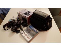 EOS 500D (13942 vues)+objectif+batterie supplémentaire+sac photo+livre
